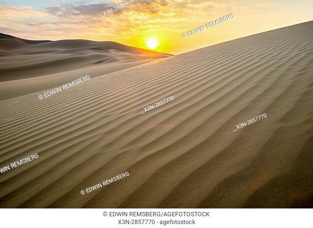 Liwa Oasis, Abu Dhabi , United Arab Emirates -, the warm sun shines over sand dunes in desert The Empty Quarter (Rub' al Khali) of the arabian peninsula is the...