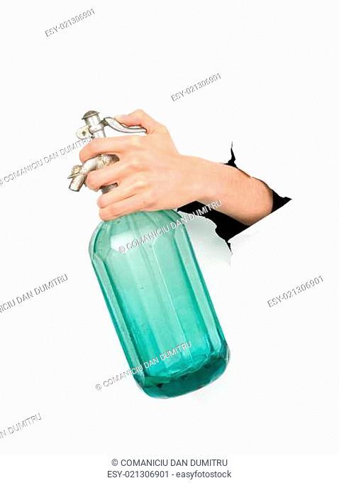 hand holding a vintage soda bottle