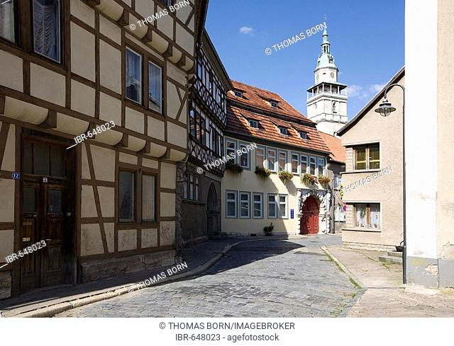 Fachwerk-style half-timbered houses in the historic city centre and the tower of St. Boniface's Church in the background, Bad Langensalza, Thuringia, Germany