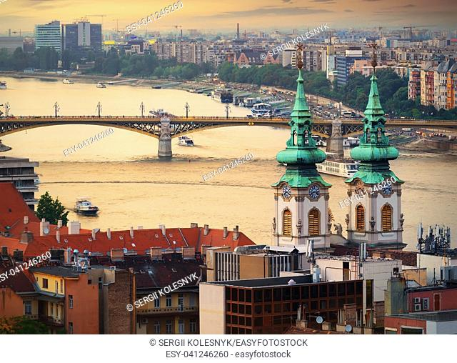 Margaret bridge and St Anna Church in Budapest at sunset, Hungary