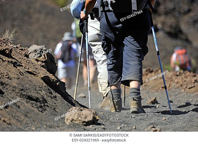 Hickers walking on volcanic dirt in the Haleakala crater, Maui Island, Hawaii Islands, Usa