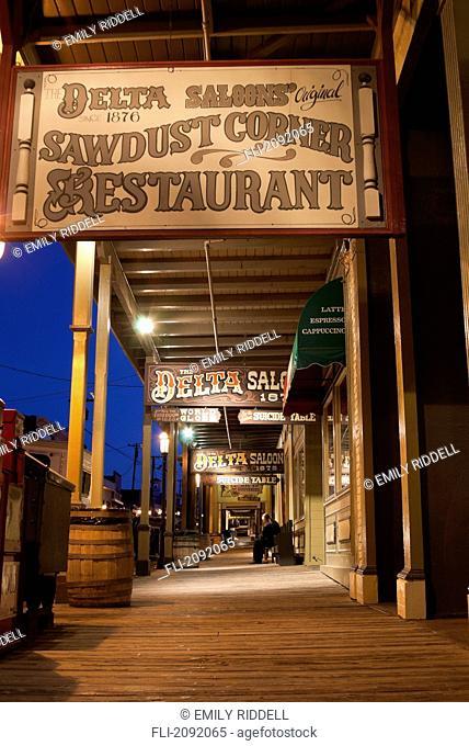 Delta saloons sign above western style walkway at dusk, virginia city nevada usa