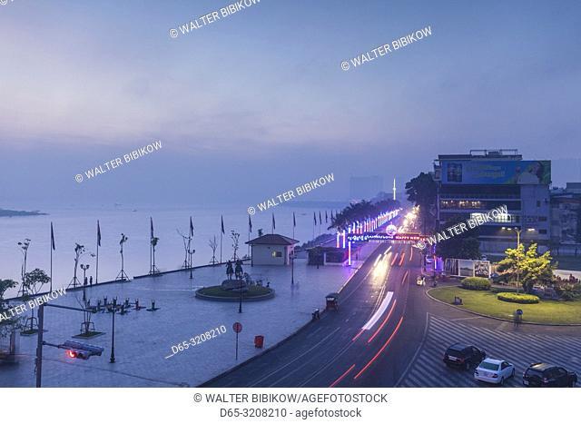 Cambodia, Phnom Penh, Sisowath Quay traffic, elevated view, dawn