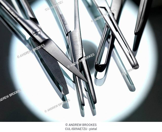 Surgical instruments on sterile tray with reflection of theatre light