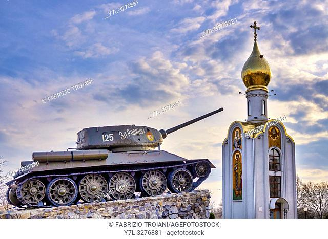 Tank momument and the orthodox church Sfantul Gheorghe in the Memorial of Glory in Suvorov Square in Tiraspol, Moldova