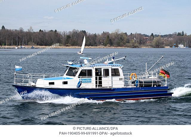 04 April 2019, Bavaria, Herrenchiemsee: A boat of the water police drives on the Chiemsee. Photo: Sven Hoppe/dpa. - Herrenchiemsee/Bavaria/Germany