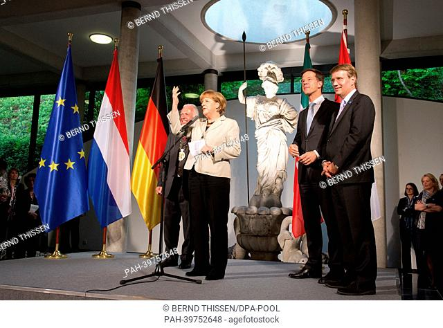German Chancellor Angela Merkel talks during a reception for first German-DutchCabinet Meeting with Mayor of Kleve Theodor Brauer (L) as well as Dutch Prime...