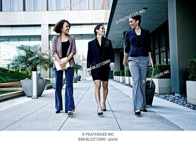 Businesswomen walking together outdoors