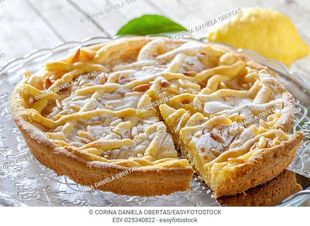 Grandmas cake, typical cake from Tuscany, Italy, made with shortbread pastry, ricotta cheese and pine nuts