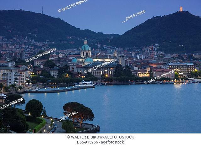 Italy, Lombardy, Lakes Region, Lake Como, Como, city view from Bellagio road, dusk