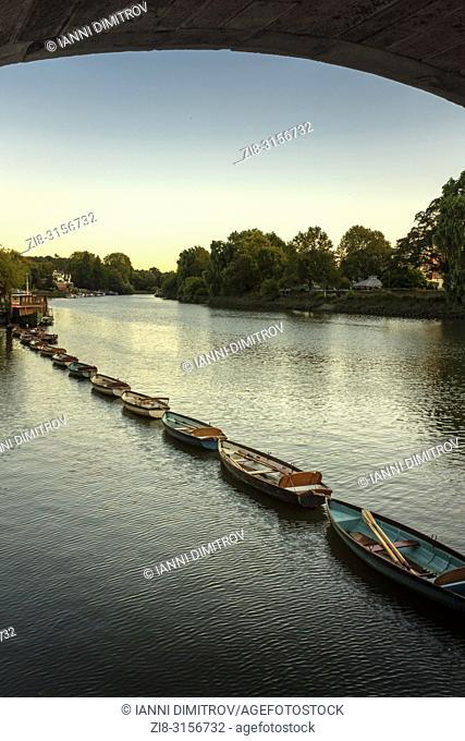 UK,Surrey,Richmond Upon Thames- moored boats under Richmond Bridge