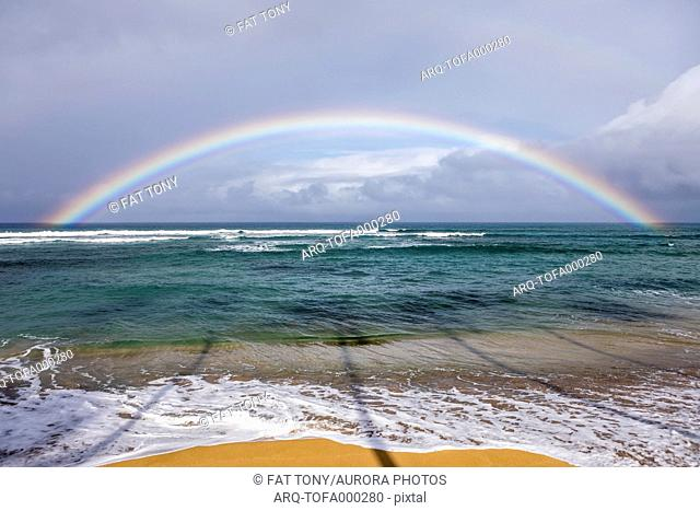 View of beach and rainbow over ocean, Lahaina, Maui, Hawaii, USA