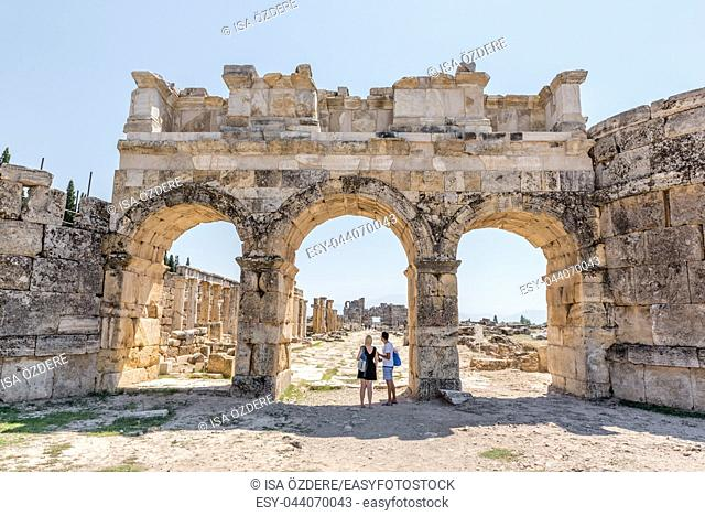 People visit The Byzantine Gate at Hierapolis ancient city in Pamukkale, Turkey