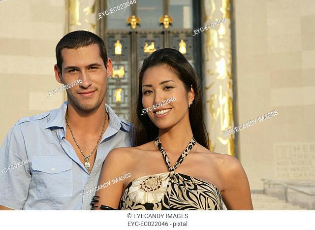 Inter-racial couple smiling at camera