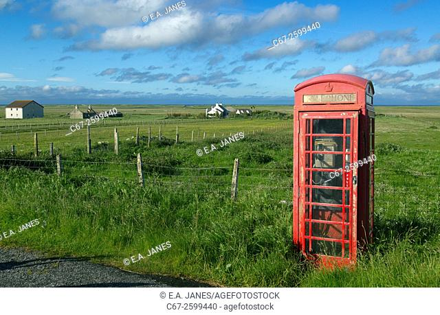 Red phone box and crofters houses at Baile Mor North Uist Outer Hebrides