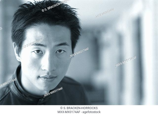 Portrait of young asian man