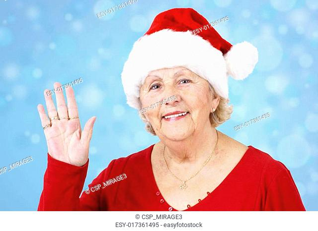Christmas hat grandma waving over blue