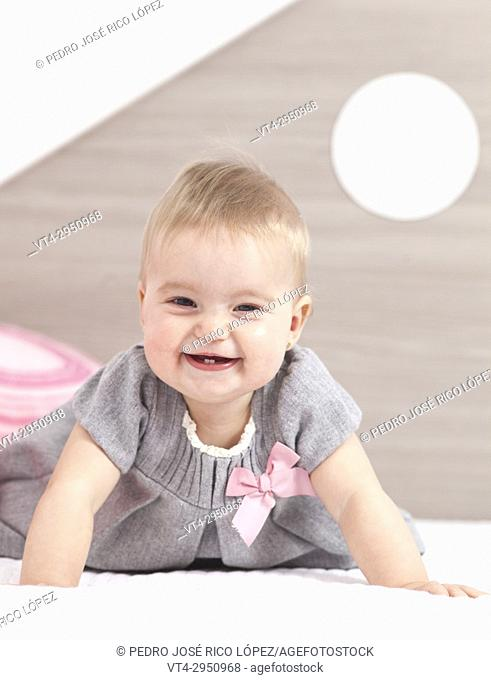 Cute baby smailing into the room