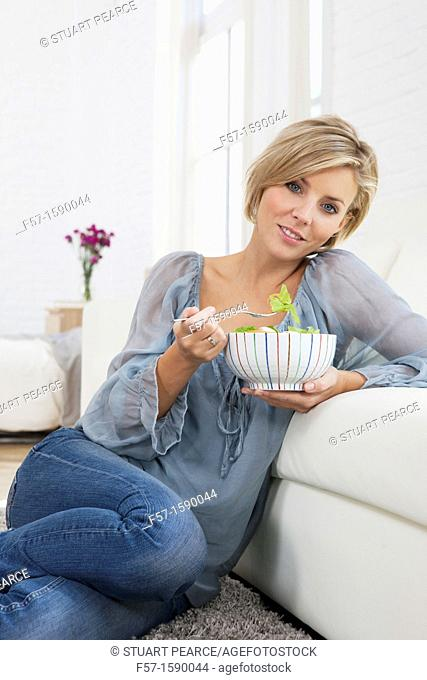 Young woman having a salad for lunch