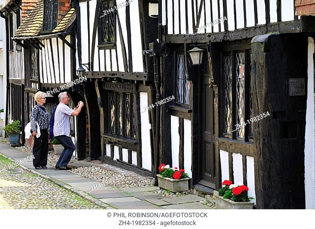Rye, East Sussex, England, UK. Black and white half-timbered houses in Church Square. Tourist taking a photo