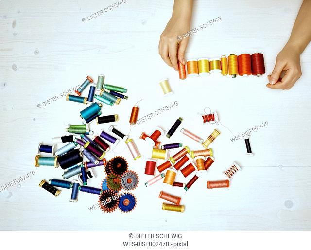 Hand sorting sewing utensils