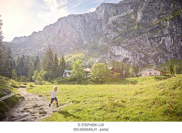 Boy running in rural setting, Benediktbeuern, Bavaria, Germany