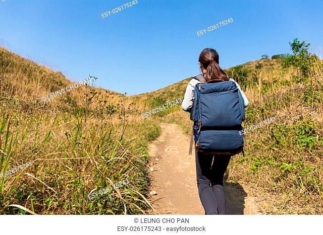 The back view of Woman go hiking