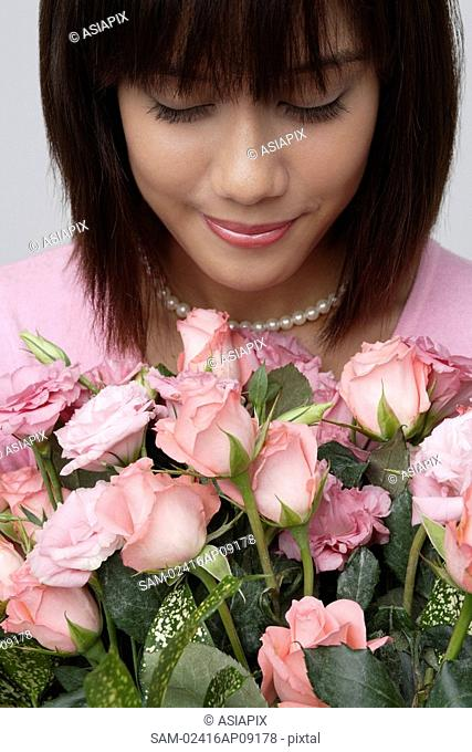 Young girl with big bouquet of flowers