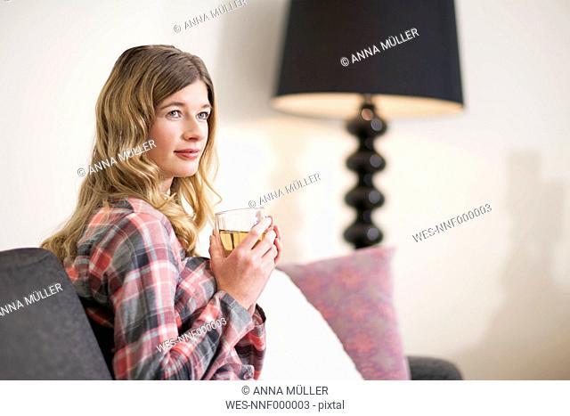 Portrait of smiling woman enjoying Sunday morning at home