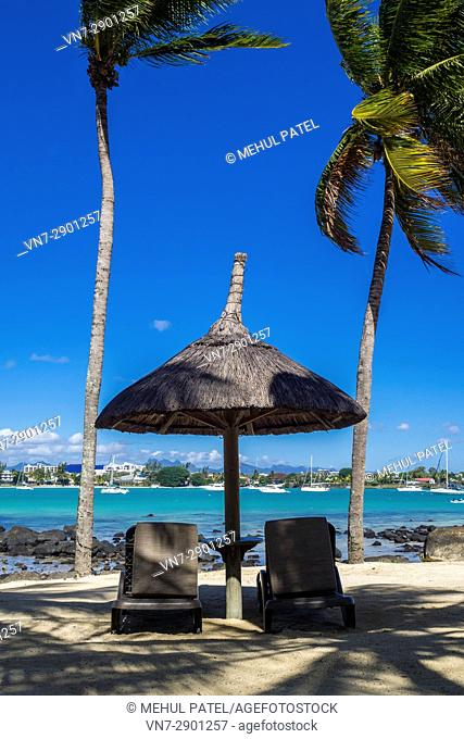 Sun loungers, Grand Baie, Mauritius. Grand Baie (or Grand Bay) is a seaside village and large tourist beach in the district of Rivière du Rempart located in the...