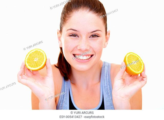 Playful young woman holding orange halves