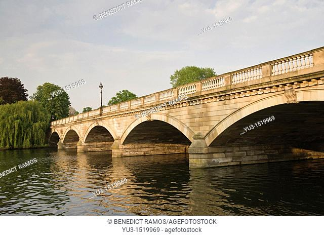 Stone road bridge over the Serpentine lake, Hyde Park, London, England, UK