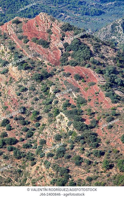 landscape in the natural park Sierra Espadán with reddish sandstone soil. Castellón. Spain