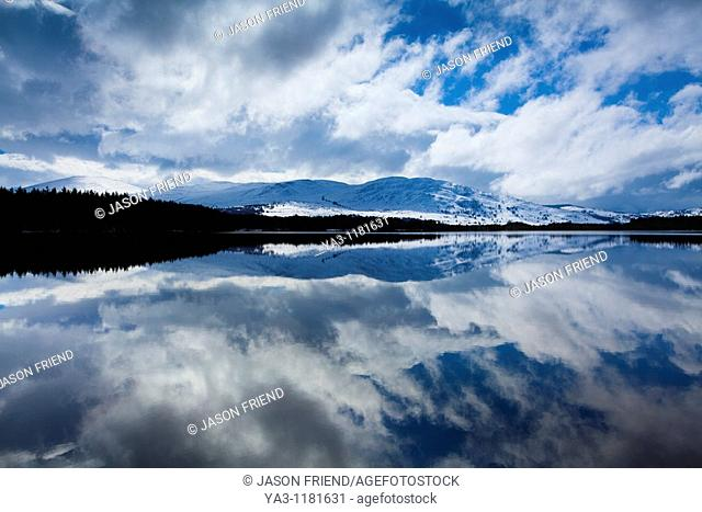 Scotland, Scottish Highlands, Cairngorms National Park  Clearing storm reflected on the still waters of Loch Garten