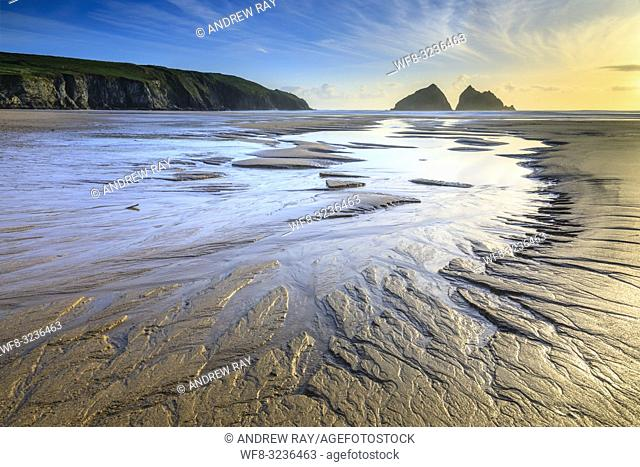 Sand patterns on the beach at Holywell Bay lead the viewers eyes towards the Carters Rocks on the North Coast of Cornwall