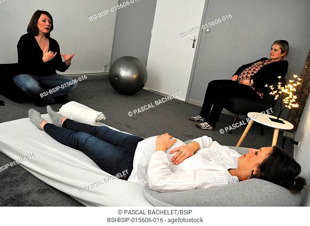 Sophrology session in a midwife's practice in Ham, France. Antenatal class for two women who are more than 8 months pregnant