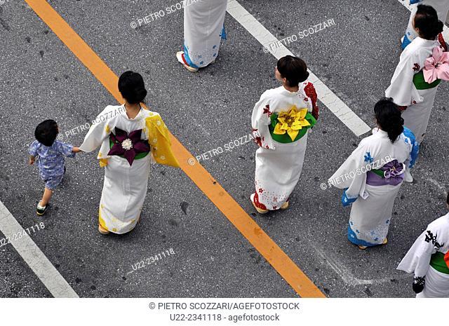 Naha, Okinawa, Japan: women in kimono during the Naha Festival, along Kokusai-dori in October