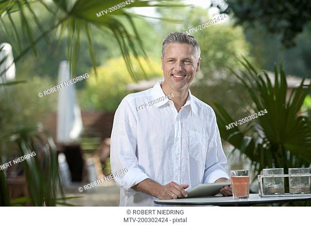 Portrait smiling relaxing drinking fruit juice man