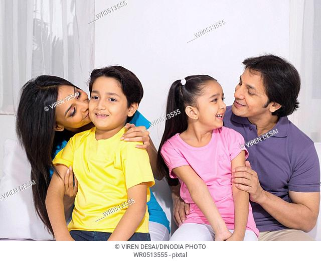 Woman kissing her son and men looking at daughter MR779P , MR779Q , MR779R , MR779S