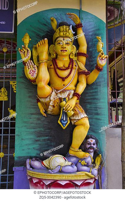 Colorful idol of Lord Shiva on the outer wall of temple, on the way to Chidambaram, Tamil Nadu, India