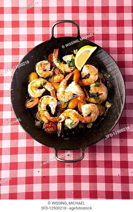 Fried prawns with yellow date tomatoes