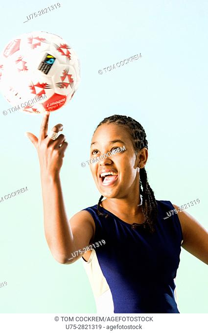 Young African woman with netball