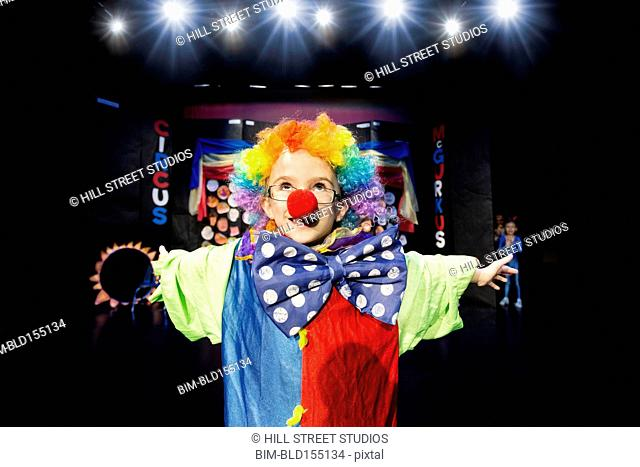 Close up of boy wearing clown costume on stage