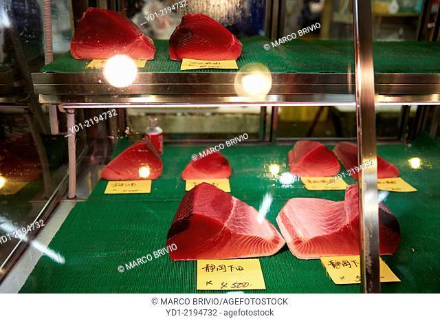 Displayed fresh tuna meat at fish market