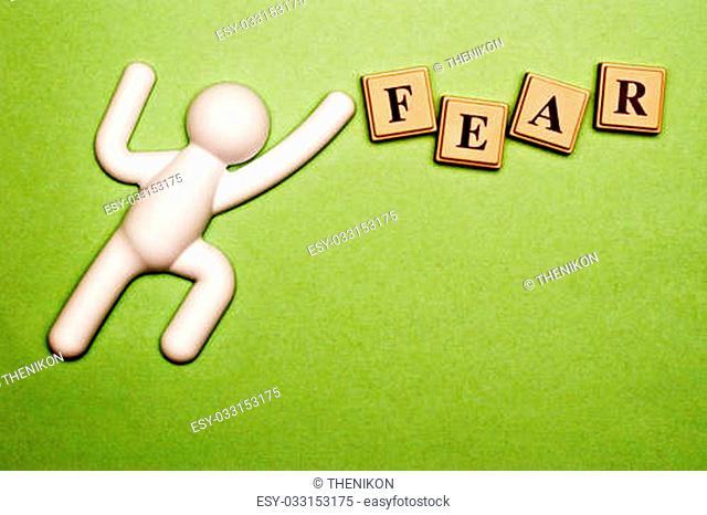 Fear spelled out in colored blocks, with stick figure