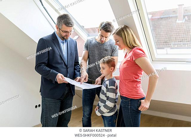 Estate agent explaining family construction plan of a penthouse