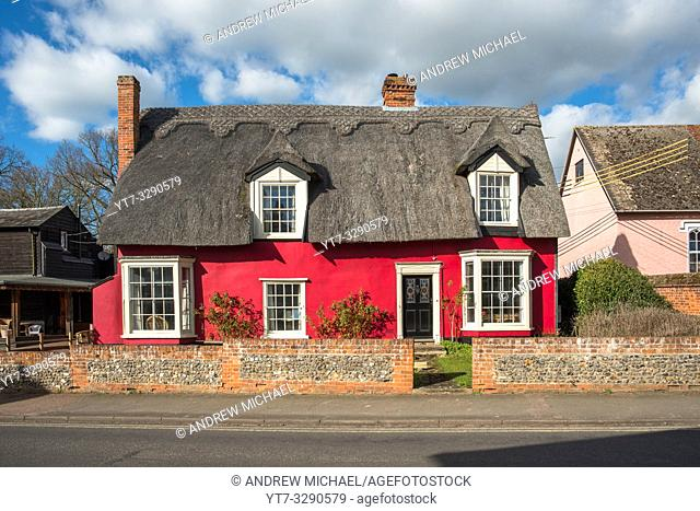Picturesque red thatched cottage at Cavendish village in Suffolk, East Anglia, England, UK