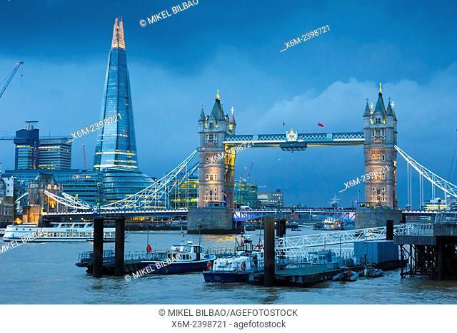 Tower Bridge, River Thames and The Shard skyscraper at night. London, United Kingdom, Europe