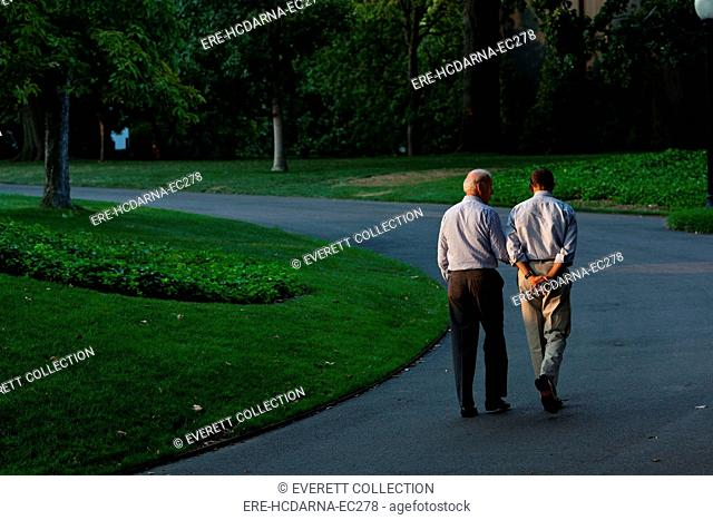 President Barack Obama and Vice President Joe Biden walk around the South Lawn of the White House, Sunday, July 24, 2011
