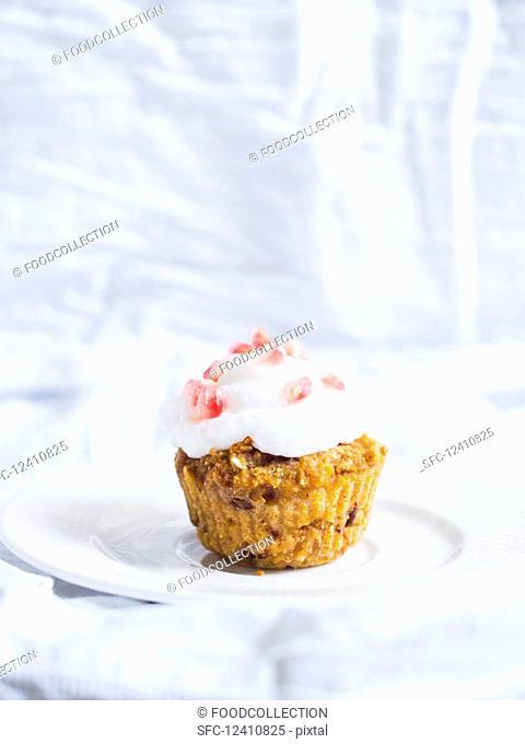 Vegan gluten free pumpkin cupcake with coconut cream topping
